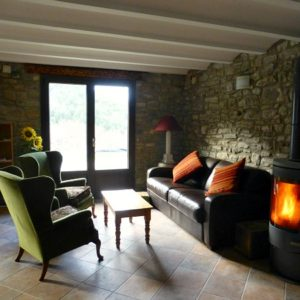 Salon with wood burning stove on Bed and Breakfast Spanish Pyrenees Holidays