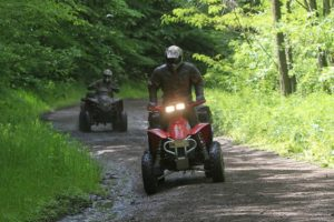 Two quad bikes going through the woods on Tailor Made Activity Holidays Spain