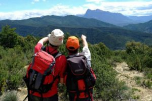 Two walkers looking at Peña Montañesa on Self Guided Walking Holidays Pyrenees