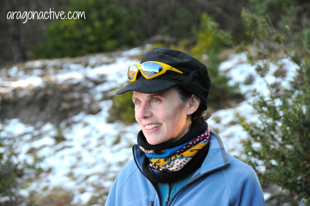 A photo of Lucy wearing hat, buff and layers on What to Wear Snowshoeing