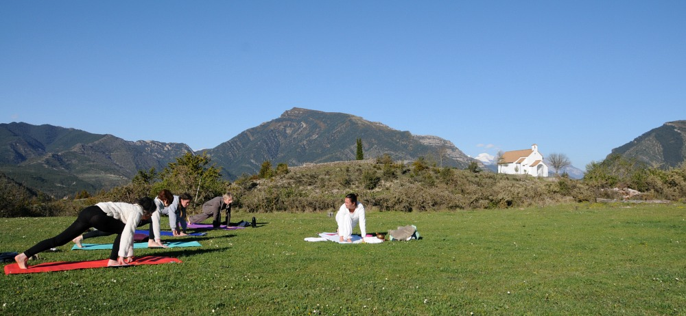 A group practising yoga outside in Albella on Yoga Meditation Retreat Spain