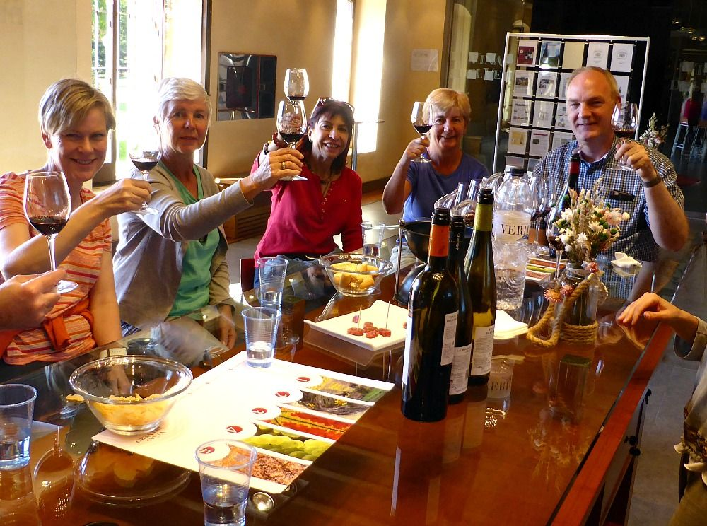 A group visits a bodega and enjoys a glass of wine on Aragon Active Cooking Holiday Spain