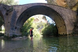 A trail runner cools her feet in the river on Aragon Active Trail Running Holiday