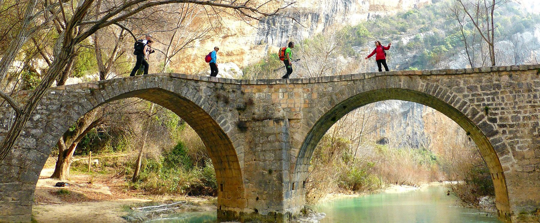 A guided walk in the Sierra de Guara crossing a medieval bridge on Aragon Active Guided Walking Holiday Spain