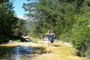 Walking up a stream in the Pyrenees to find a pool to swim on the Yoga Meditation Retreat Spain with Aragon Active