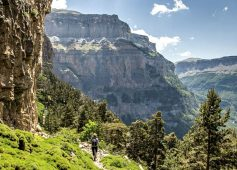Walking on a faja in the Ordesa National Park with views down the Ordesa canyon on Aragon Active Self Guided Walking Holiday Spain