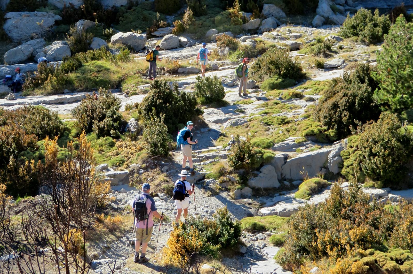 Guests walking down a dry stream bed on Aragon Active Cooking Holiday Spain