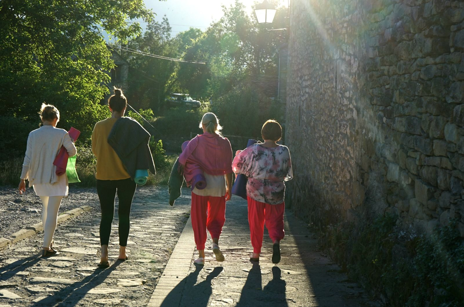 A yoga group walk down the village of Albella going to an outdoor class on the Yoga Meditation Retreat Spain with Aragon Active