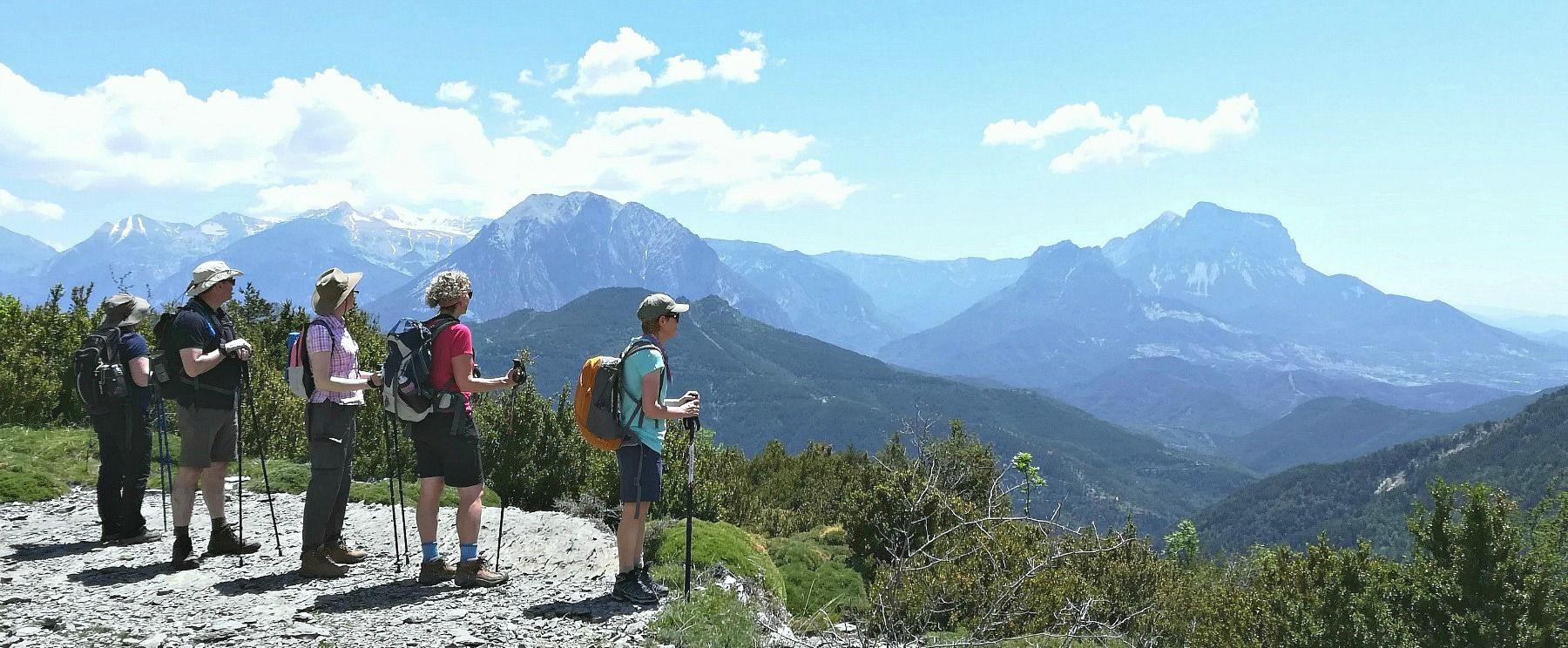 A group of walkers standing looking at the panoramic view of the Pyrenees on Aragon Active Guided Walking Holiday Spain