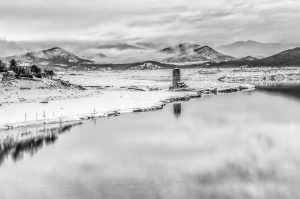 A winter photograph in black and white photo of the church at Mediano in the Pyrenees taken on Photography Holiday Spain with Aragon Active