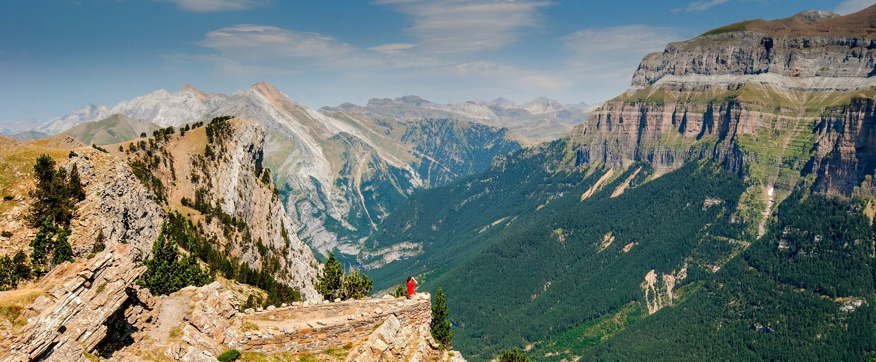 A person looks at the incredible view from a viewing balcony overlooking the Ordesa valley in the Pyrenees on Aragon Active Cooking Holiday Spain