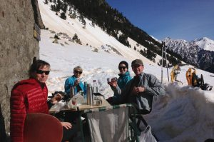 Snowshoeing but still time to stop for a picnic by a refuge in the Pyrenees on Snowshoeing Holidays Pyrenees with Aragon Active