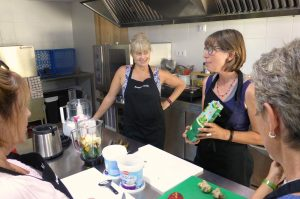 A workshop in the kitchen at Casa Allué demonstrating the simplicity of cooking raw on the Yoga Meditation Retreat Spain with Aragon Active