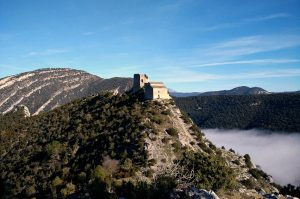 A photo of an 11th century fort in the Pyrenees high on mountain above the clouds on Snowshoeing Holidays Pyrenees with Aragon Active