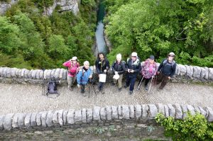 Guests with our mountain guide on a medieval bridge in the Ordesa National Park on Aragon Active Tailor Made Activity Holiday Spain