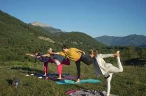 Four yogis enjoy a class outside in the Spanish Pyrenees with Aragon Active on the Yoga Meditation Retreat Spain
