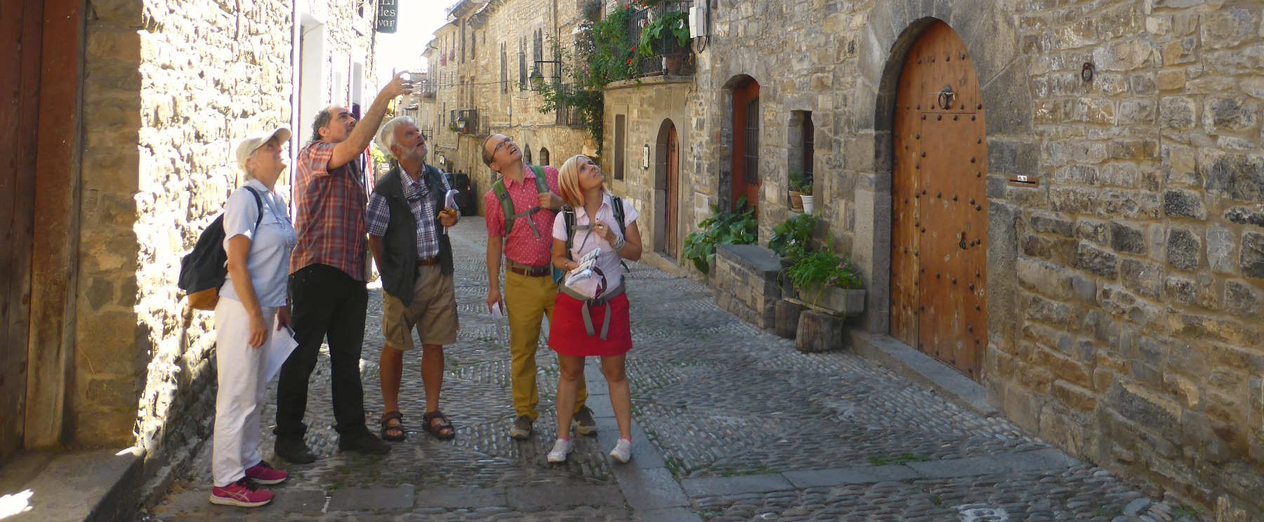 A group do role play in the historic town of Ainsa on Aragon Active Learn Spanish Holiday