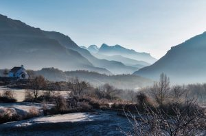 A morning view of the mist shrouded mountains and chapel of San Urbez in the hamlet of Albella in the Spanish Pyrenees. Our base for our Trail Running Holiday