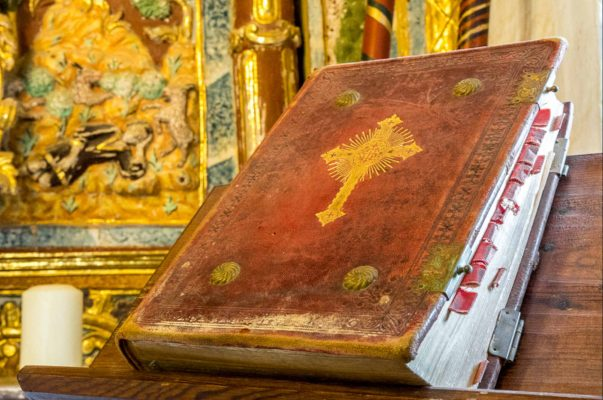 A bible in the 16th century chapel of San Urbez in Albella which we visit on our Cultural Holiday Spain