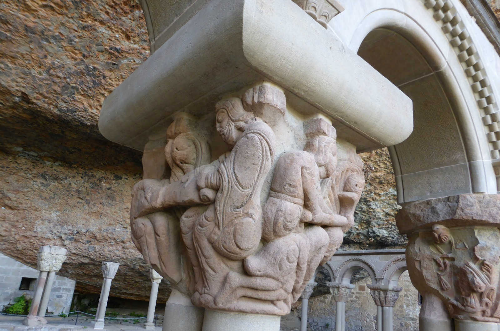 A close up of a capital carved in stone and depicting Christ with his disciples in the monastery of San Juan de la Peña on our Cultural Holiday Spain