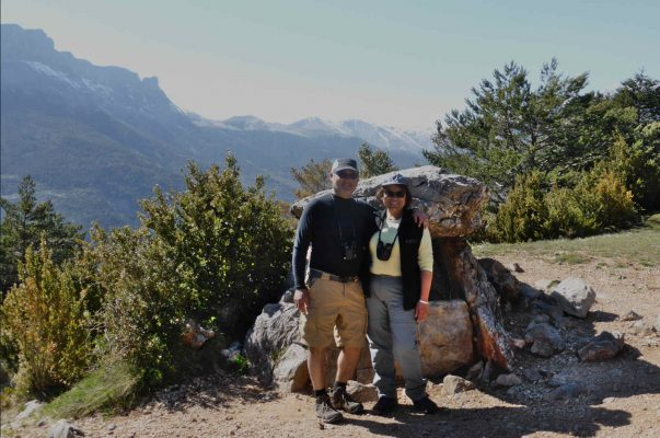 Two guests stand by a neolithic dolmen in the Spanish Pyrenees on our Cultural Holiday Spain