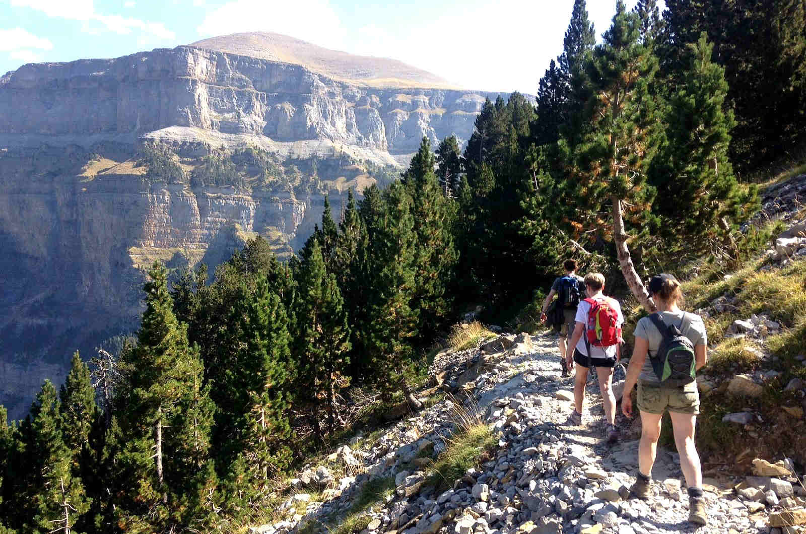 Thrree walkers on a high path in the Spanish pyrenees on our Guided Walking Holiday Spain