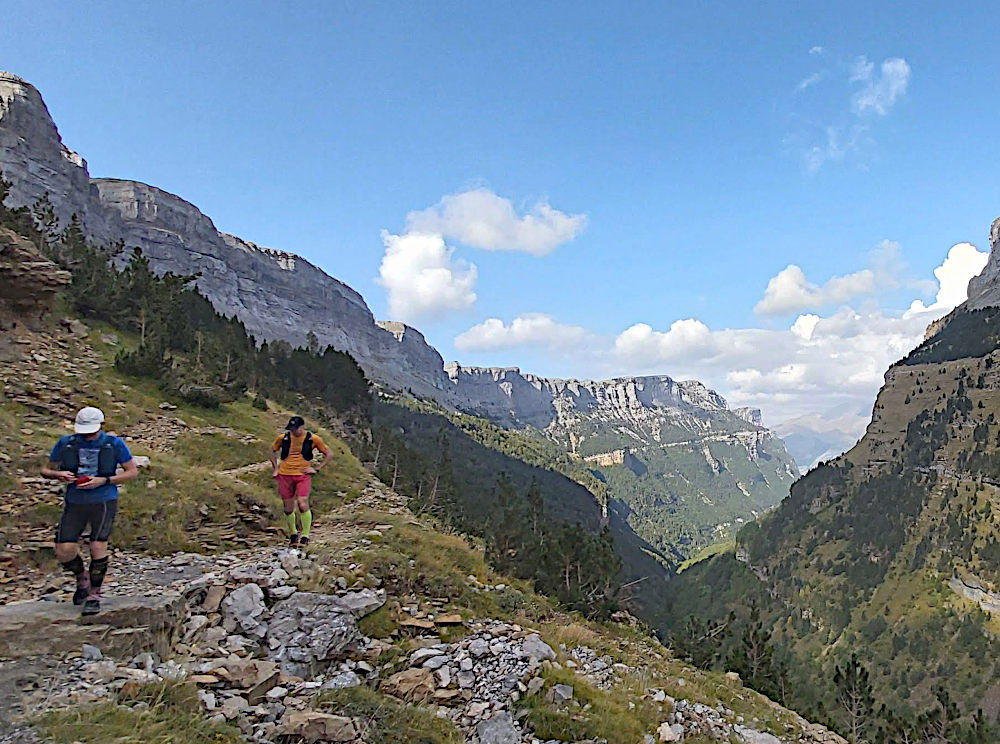 Two male trail runners high above the Ordesa valley with views 1km down on our Trail Running Holiday
