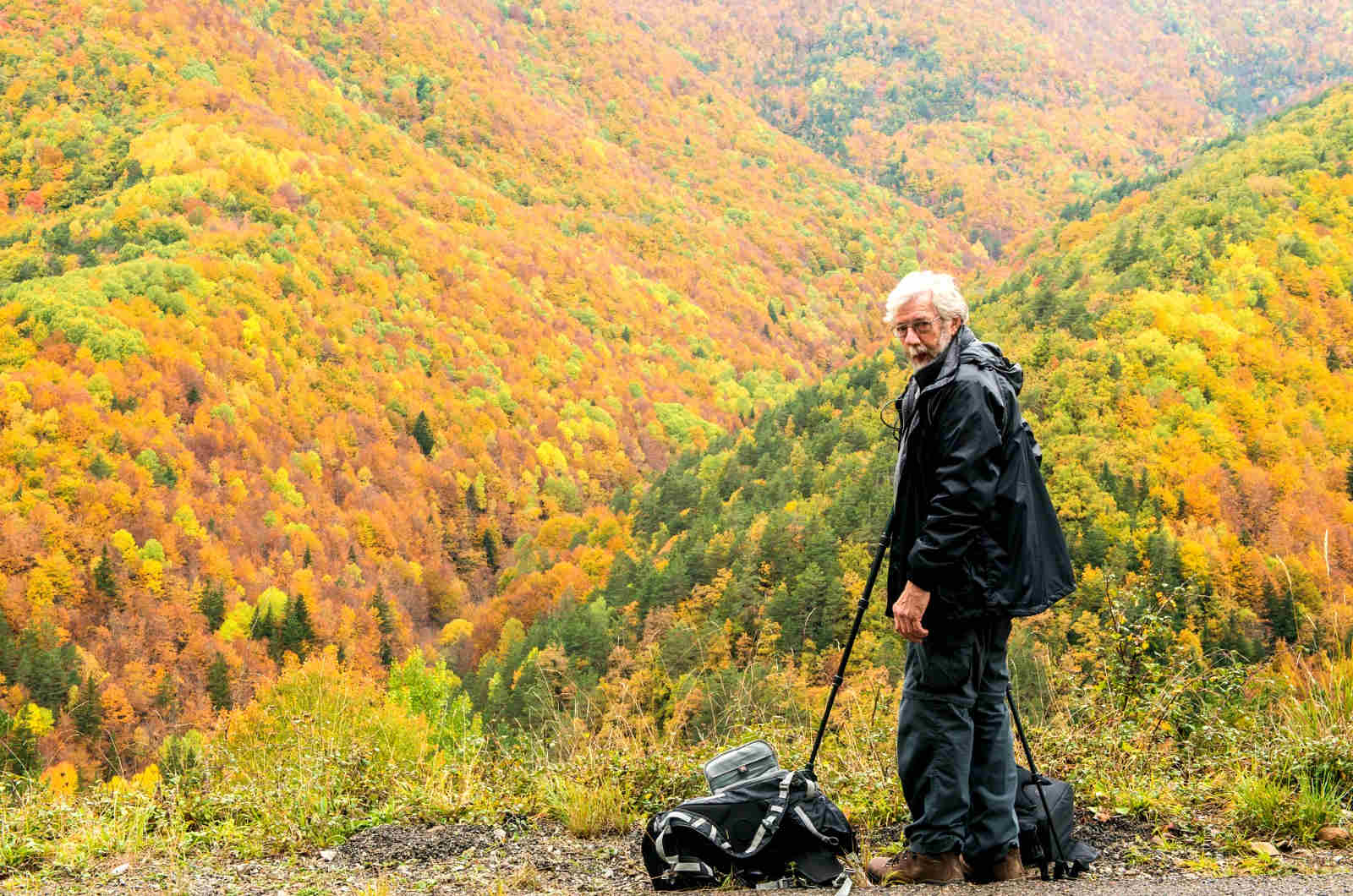 A photographer sets up to photograph the incredible autumn colours in the Spanish Pyrenees on our Photography Holiday Spain