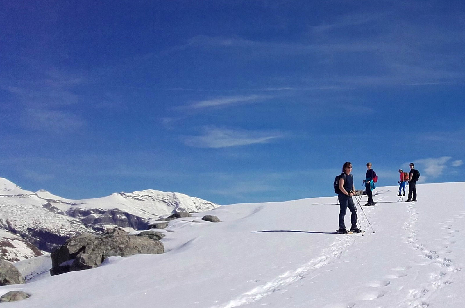 A group climb Mondoto in the Spanish Pyrenees in snow shoes on our Snowshoeing Holidays Pyrenees