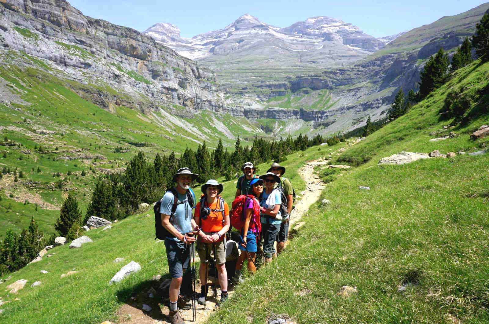 A photo of a group of hikers on a narrow path high in the ordesa valley with Monte Pedido in the background on our Guided Walking Holiday Spain