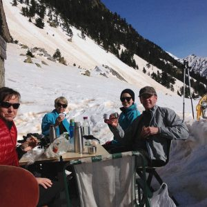 Burgoña enjoys a picnic outside at a refuge on our Snowshoeing Holidays Pyrenees