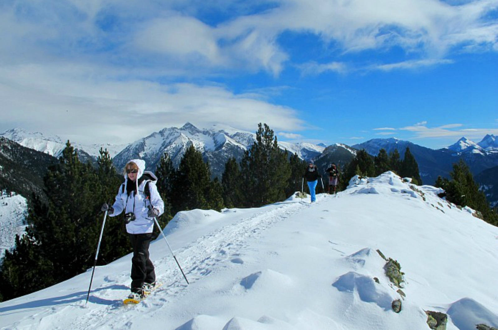 Walking on a ridge in snowshoes in the valley of Pineta in the Spanish Pyrenees on our Snowshoeing Holidays Pyrenees