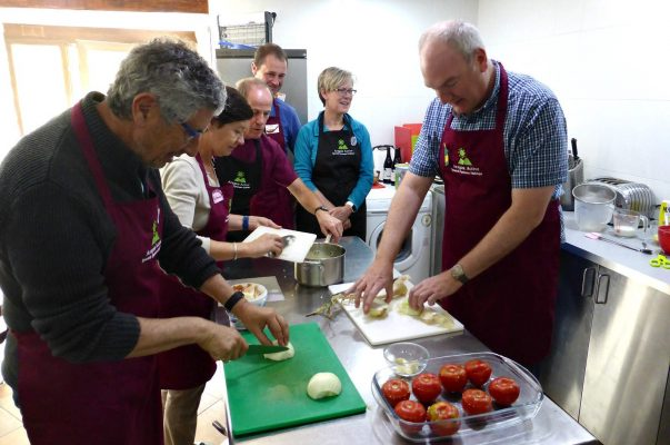 A cookery workshop with us gathered around a table on a Cooking and Walking Holiday Spain