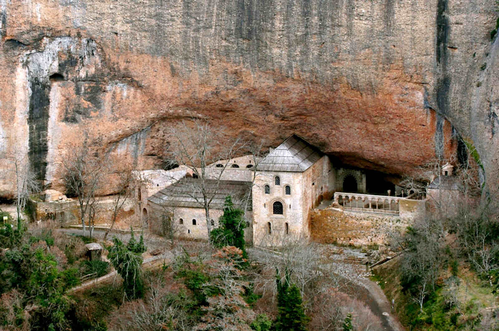 A view of the 10th century monastery of San Juan de la Peña at Jaca set in the mountain side on a visit on our Cultural Holiday Spain