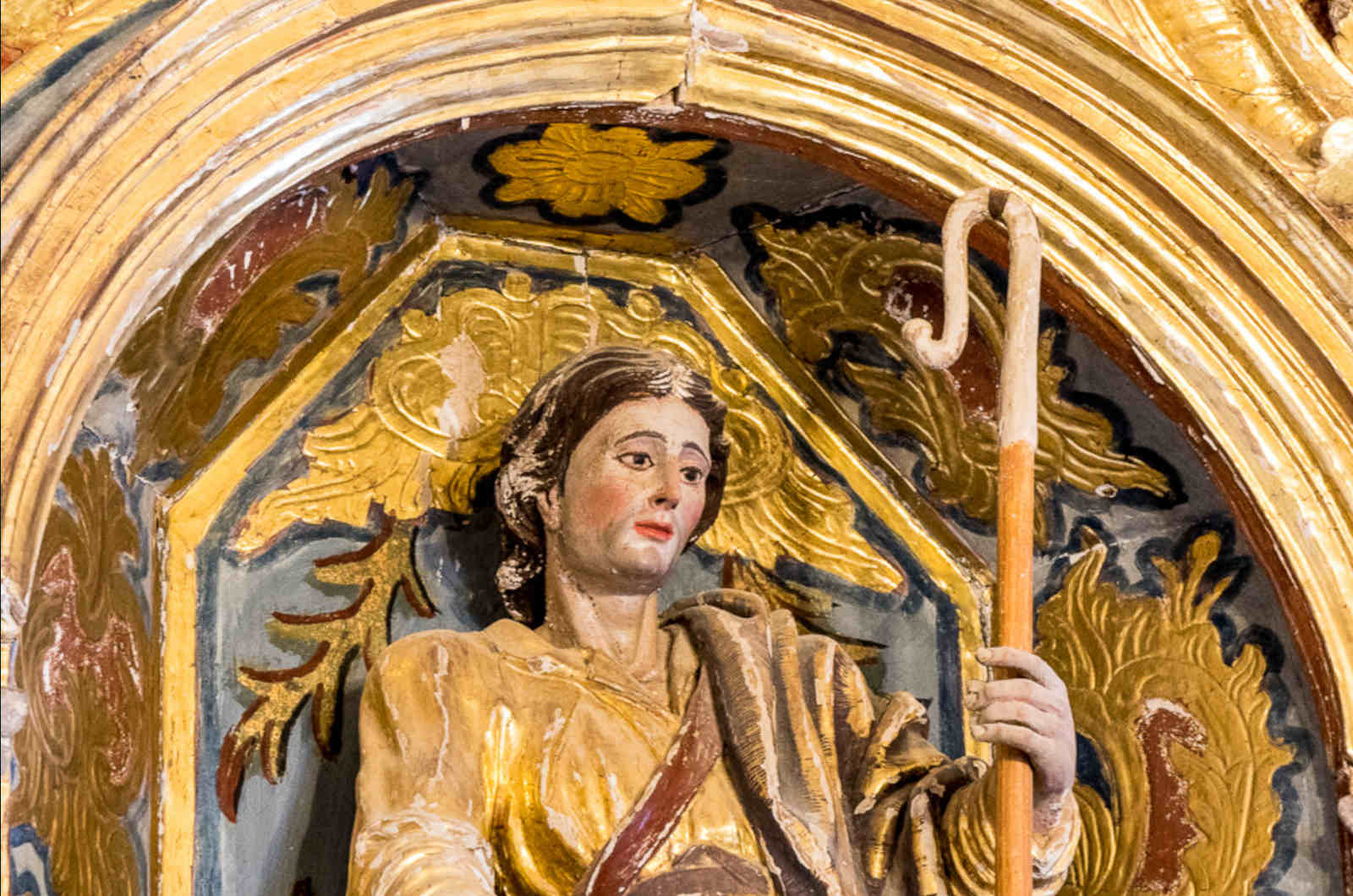 A close up of the painted wood carving of the shepherd San Urbez in the chapel at Albella on our Cultural Holiday Spain