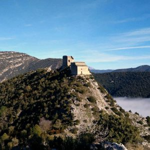A view of the castle and church of Samitier high on a mountain top in the Spanish Pyrenees on our Snowshoeing Holidays Pyrenees