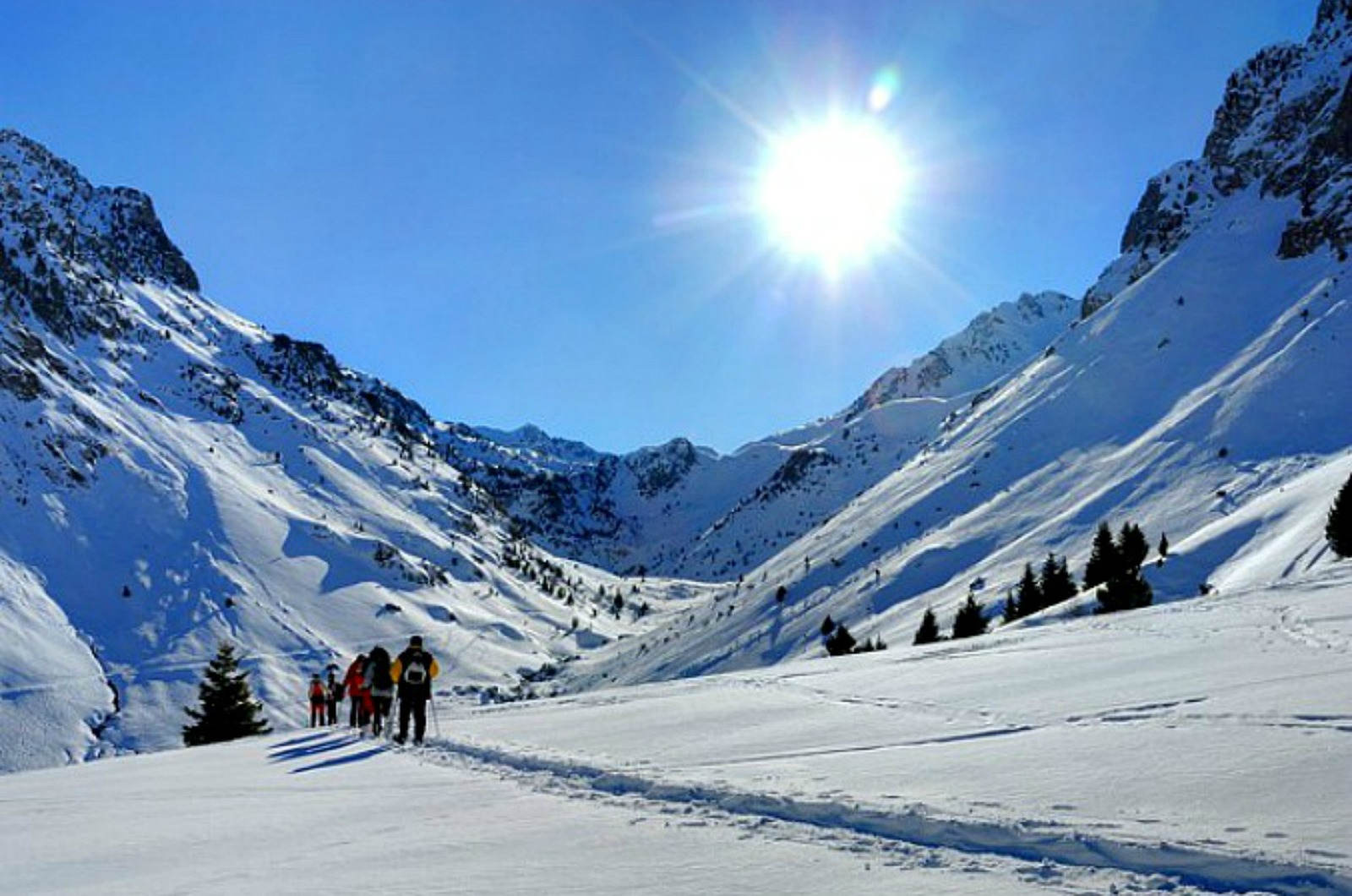 A group head towards the French border on snow shoes on our Snowshoeing Holidays Pyrenees