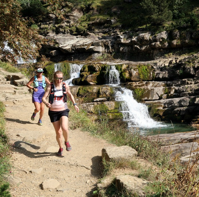 Two female trail runners descend from the cola de Caballo in the Spanish Pyrenees on our Trail Running Holiday