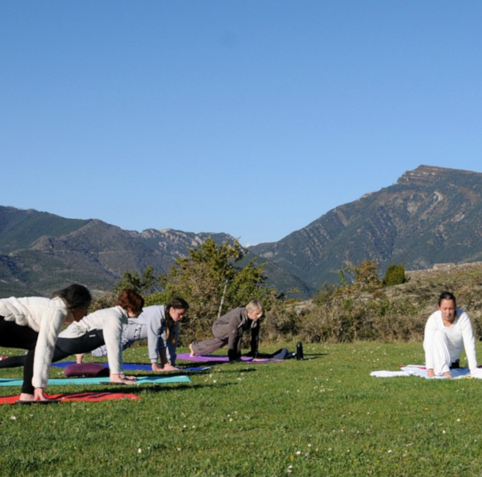 Our yoga teacher takes a class outside in the village of Albella in the Spanish Pyrenees on our Yoga and Walking Retreat Spain