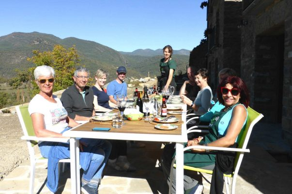 A group lunch outside on the terrace at Casa Allúe on a Cooking and Walking Holiday Spain
