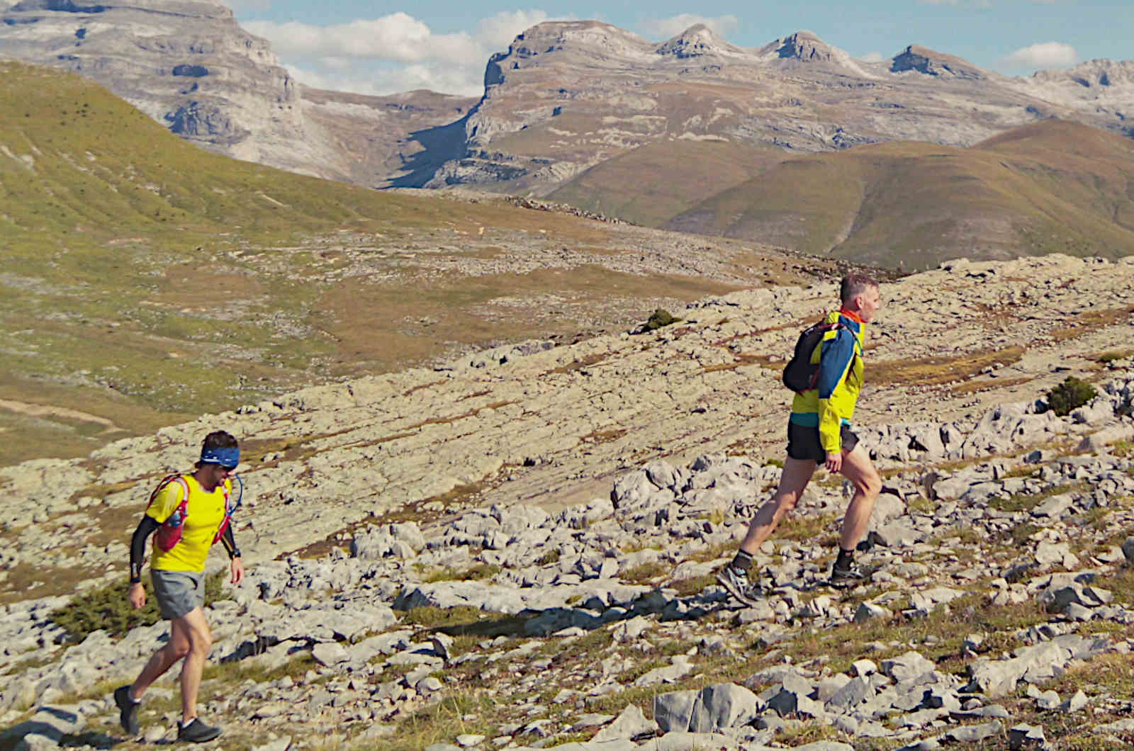 Two male trail runners make there way up Mondoto in the Spanish Pyrenees on our Trail Running Holiday