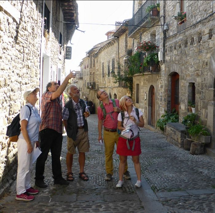 Learn Spanish students acting as tour guides in Ainsa on the Aragon Active Learn Spanish Holiday