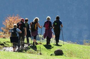A guide leading a group of walkers in the high pastures of Ordesa on Aragon Active Guided walking Holiday Spain