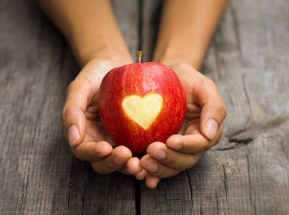 A fresh apple with a heart in the middle as a symbol of freshness on Aragon Active Juice Retreat Spain