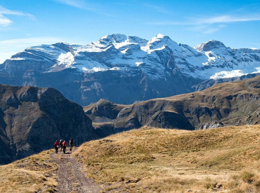 A group on a high walk in the Pyrenees looking for Chamois on the Aragon Active Natural History Holiday