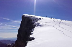 Snowshoeing on a dramatic ridge high in the Pyrenees on Snowshoeing Holidays Pyrenees with Aragon Active