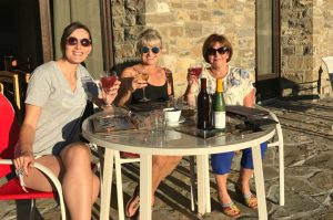 Guests relaxing on the terrace as the sun sets at Casa Allué in the Pyrenees on Aragon Active Juice Retreat Spain