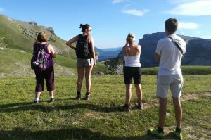 A yoga group pause to look out across the Pyrenees on the Yoga Meditation Retreat Spain with Aragon Active