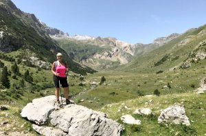 """A yogi stands with c classic Pyrenees """"U"""" shape valley behind on a gentle walk with Aragon Active on the Yoga Meditation Retreat Spain"""