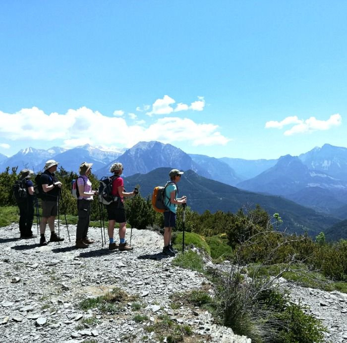 A group of walkers gazing from a high plateau at the view of the Pyrenees on Aragon Active Tailor Made Activity Holiday Spain